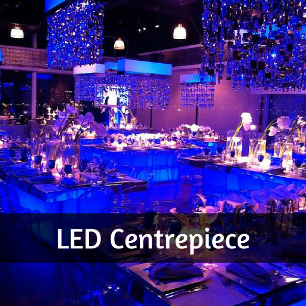 LED lightup centrepieces in a function room giving a blue glow throughout the room