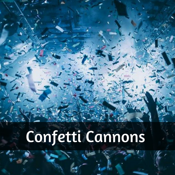 Phtot of hands in the air at a concert and confetti falling from the ceiling