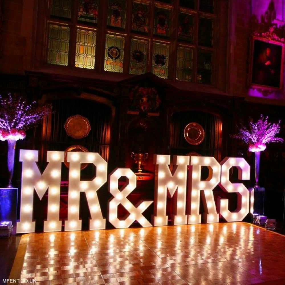 Giant light up Mr. & Mrs. sign on wedding dancefloor
