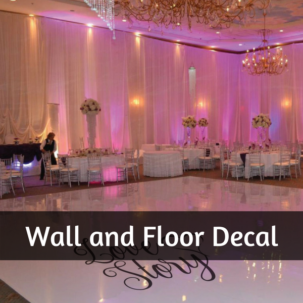 Wedding dance floor with personalised art decal stickers, draped backdrop and coloured lighting in the function room
