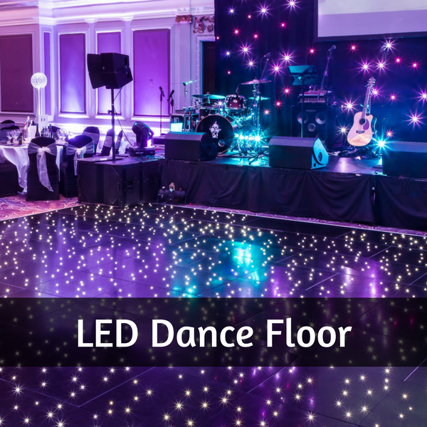 Photo of a function room with LED dancefloor and a sparkly LED backdrop behind the band stage