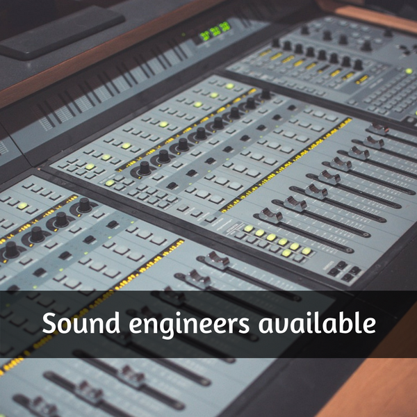 "Photo of a sound engineers mixing table with the text ""Sound engineers available"" across the bottom"