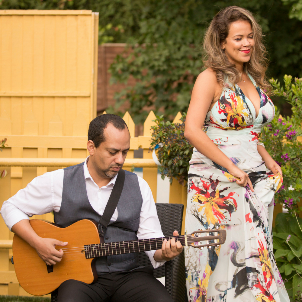 Luana Matos (Vocal) and Robson Rocha (Guitar) performing at a garden wedding