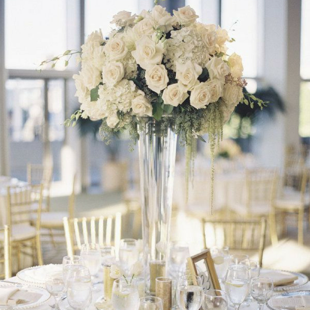 Elegant, ivory rose centrepiece in tall glass vase